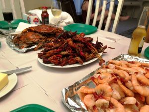 Seafood boil with crab, crawfish, and jumbo shrimp